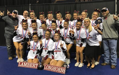 Varsity competition cheerleaders take first place at state competition