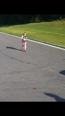 Me running my first 5k as a sophomore... You can't really tell from this picture but I was definitely suffering.