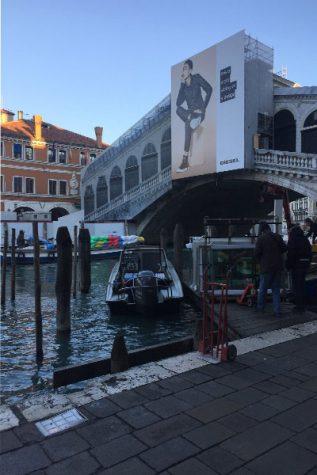 Realto Bridge in Venice, Italy remains under construction as the morning sun rises.