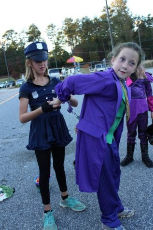 This police officer decided to handle matters quietly on the other side of the parking lot, as she arrested the Joker.