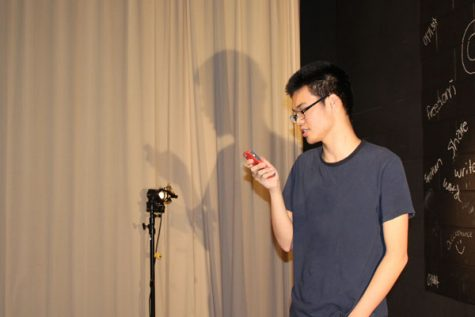 """Sophomore Eric Zhu recites an original poem called """"The Easy Way Out""""."""