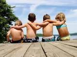 Friends sitting on a dock.