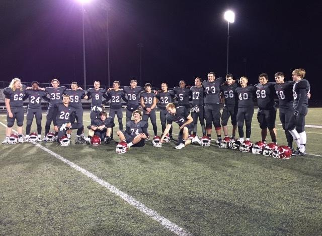 The 2015 varsity football team posed together after their final game, before saying fairwell to the friends they had grown so close to on the team.