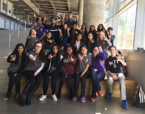 LHS Science Olympiad team smiles bright  at the camera as they take on their region competition in downtown.