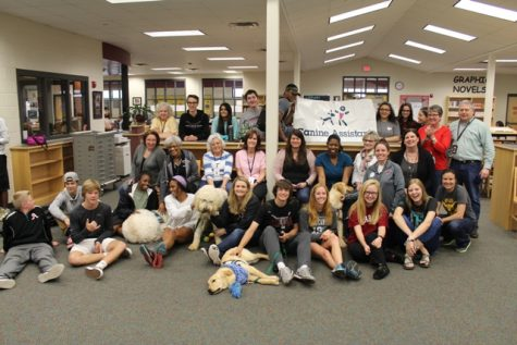 Lambert students pose with the Canine Assistants and thank them for sharing their canine companions