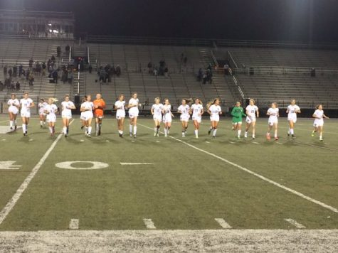 The Girls' Varsity team takes a victory jog after their incredible win over Grayson.