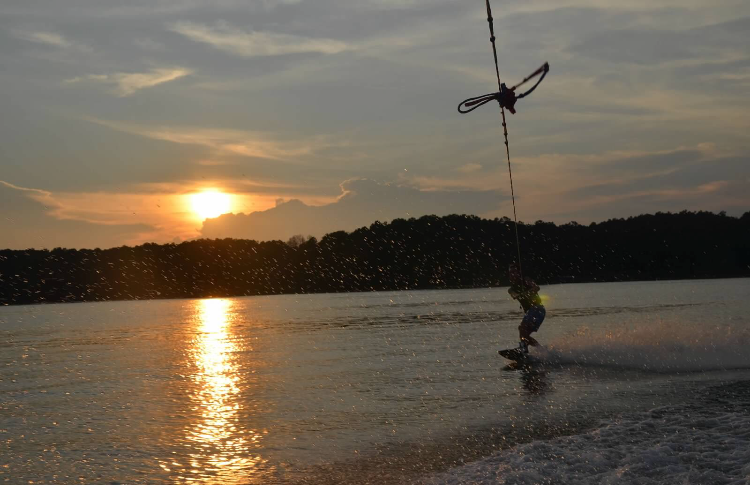 Adventure is worth while in itself -Amelia Earhart    This picture describes an adventure itself. This is when I started to get the hang of wake boarding. It started with lots of attempts of falling and trying my best but then it clicked. I started getting up and moving in and out of the wake like I knew what I was doing. By the end of the day I was getting little jumps down, and to think I was against trying it all along at the start of the day.  -Jake Alesia