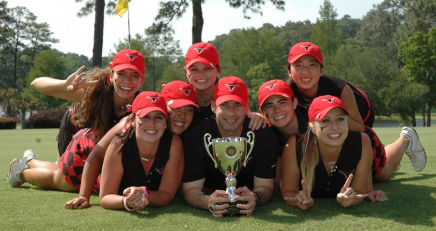 The girls golf team poses for a picture after their big win.