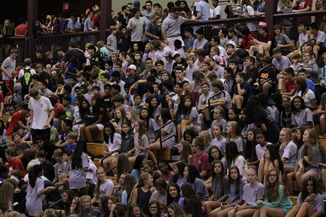 The freshmen crowd looks onto the pep rally trying to set an example of how to be cool.