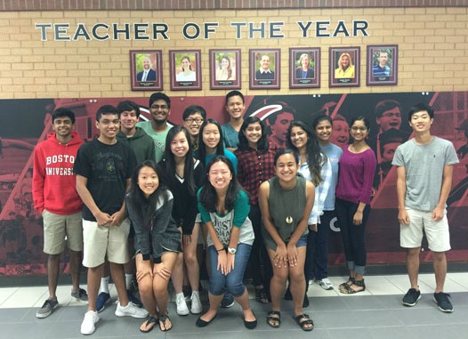 This year's Lambert National Merit Semi-Finalists (back row, L-R: Hari Pingali, Amitesh Chandra, Naren Reddy, Sai Kilaru, Jake Kwon, Kevin Tao; middle row, L-R: Elynna Chang, Christina Sun, Mehnaz Rukshana, Tanya Roy, Janani Guru, Elijah Kim; front row: Stephanie Tian, Hannah Kim, Natasha Ramaswamy)  are all smiles for a photo.