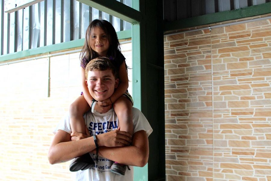 Milena sits on my shoulders on the last day at the school, right before we said goodbye.