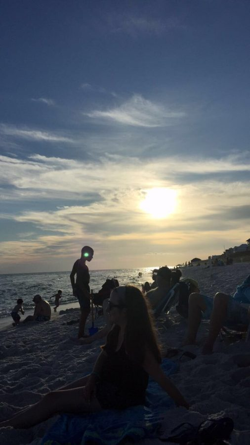 People gather on the beach to view the sunset one  summer evening in Seacrest, Florida.