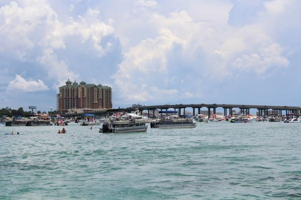 One major stop my family and I made was Crab Island. It wasn't like the first island we found. As our boat got closer and closer to the dock, there were millions of boats floating atop the blue water. Music was blasting in the background and there were so many people in the water and on boats. I wanted to get off the boat and physically go to Crab Island myself, but with so many people in between the dock and the boat my family was on, we could not; we would have never made it through.