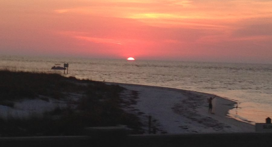 The sun sets over the Gulf of Mexico in Longboat Key, Florida, epitomizes the beauty and serenity of the island town.
