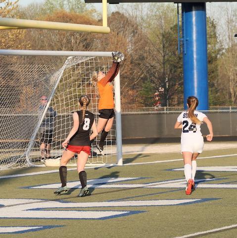 Jordyn blocking a goal during a game.
