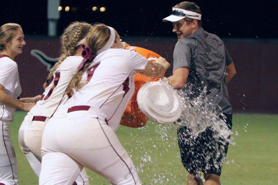 Coach Brooks Youngblood attempts escape from the celebratory ice bath.