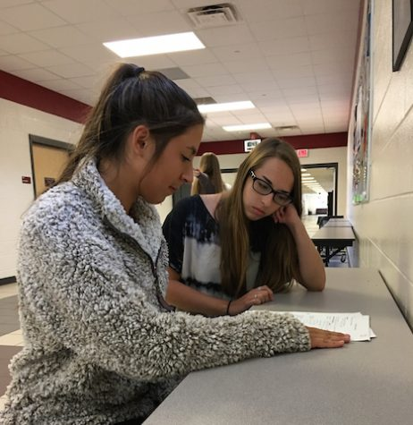 Beta Club member Brenna Reilly tutors Madison Powers in order to receive service hours.