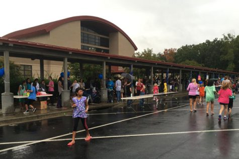 Despite the rain, carnival attenders have fun by socializing and exchanging tickets for prizes.