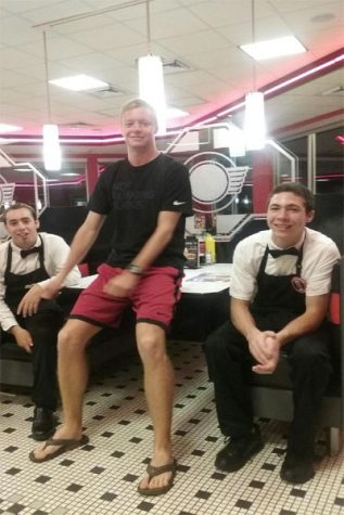 (From left to right) Collin Burt (senior) and Max Kimble (junior) , both full time students at Lambert, smile at the camera during their short break off at Steak 'n Shake.
