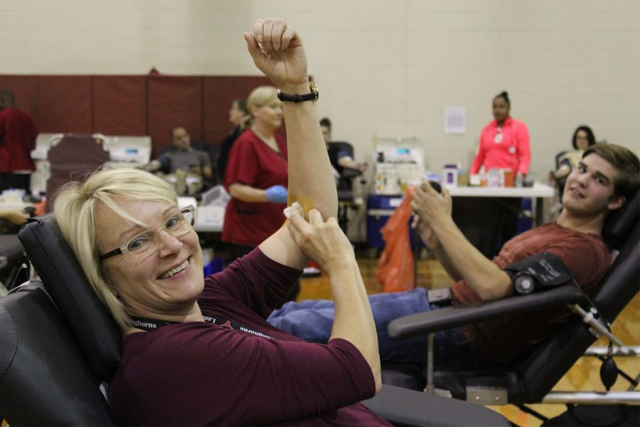 Teachers and students come together to give blood for a good cause.
