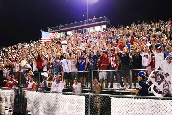 Lambert students showing their pride at the homecoming game