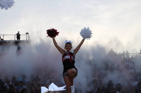 One of many extracurricular activities at Lambert, cheerleaders spend their Friday nights at football games, and have regular practices throughout the week.