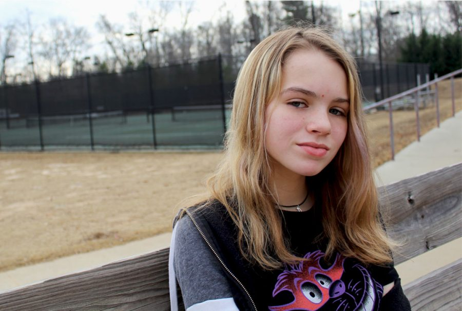 Sitting outside by the tennis courts, freshmen Hanna Wood explains what it's like to have  ADHD and how it affects her life.