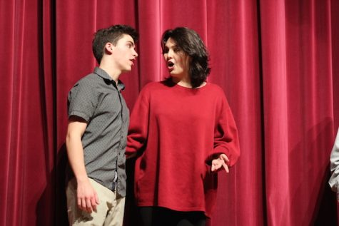 Dean Mckenzie and Hanah Feinstein collaborate to finish their improv act.