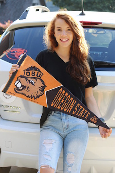 Victoria Shelton proudly holds her Oregon State flag.