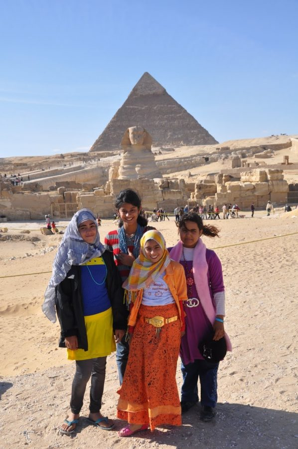 A quick shot of Mahima Siripurapu (author of the article) with some new friends in front of the Great Pyramid of Giza, in Egypt, a country with a muslim majority.