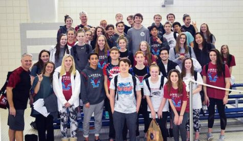 Lambert's mens and womens swim and dive teams pose for a picture on the first day of the competition.