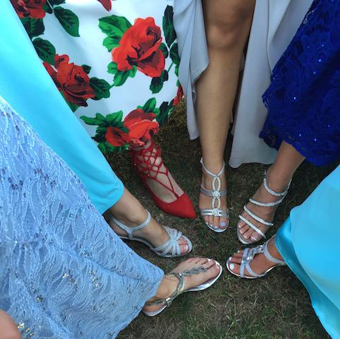 Prom shoes are seen for thirty seconds for a quick picture then hidden under the dresses again.