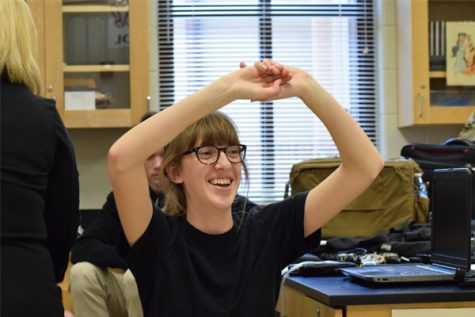 Forensic student Hannah Saylor raises her hands as a part of a polygraph demonstration.