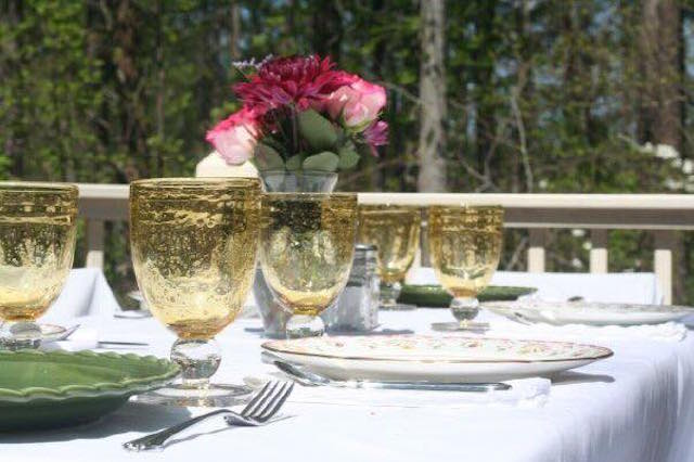 The table was beautifully set  with decorative glasses and bright flowers for a pre-prom dinner.