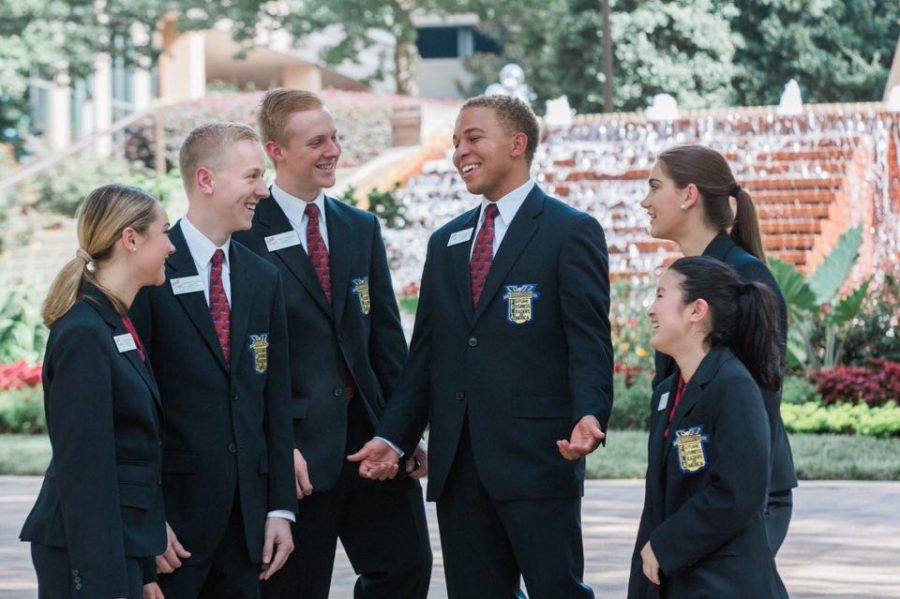 Lambert student Royce Dickerson laughing with the other FBLA Georgia State officers, (from left to right) state reporter Macy McKinely, state projects vice president Mathew McDaniel, state membership vice president Nick Loudermilk, state president Royce Dickerson, state parliamentarian Catherine Farist, and state secretary Shelly Ling.