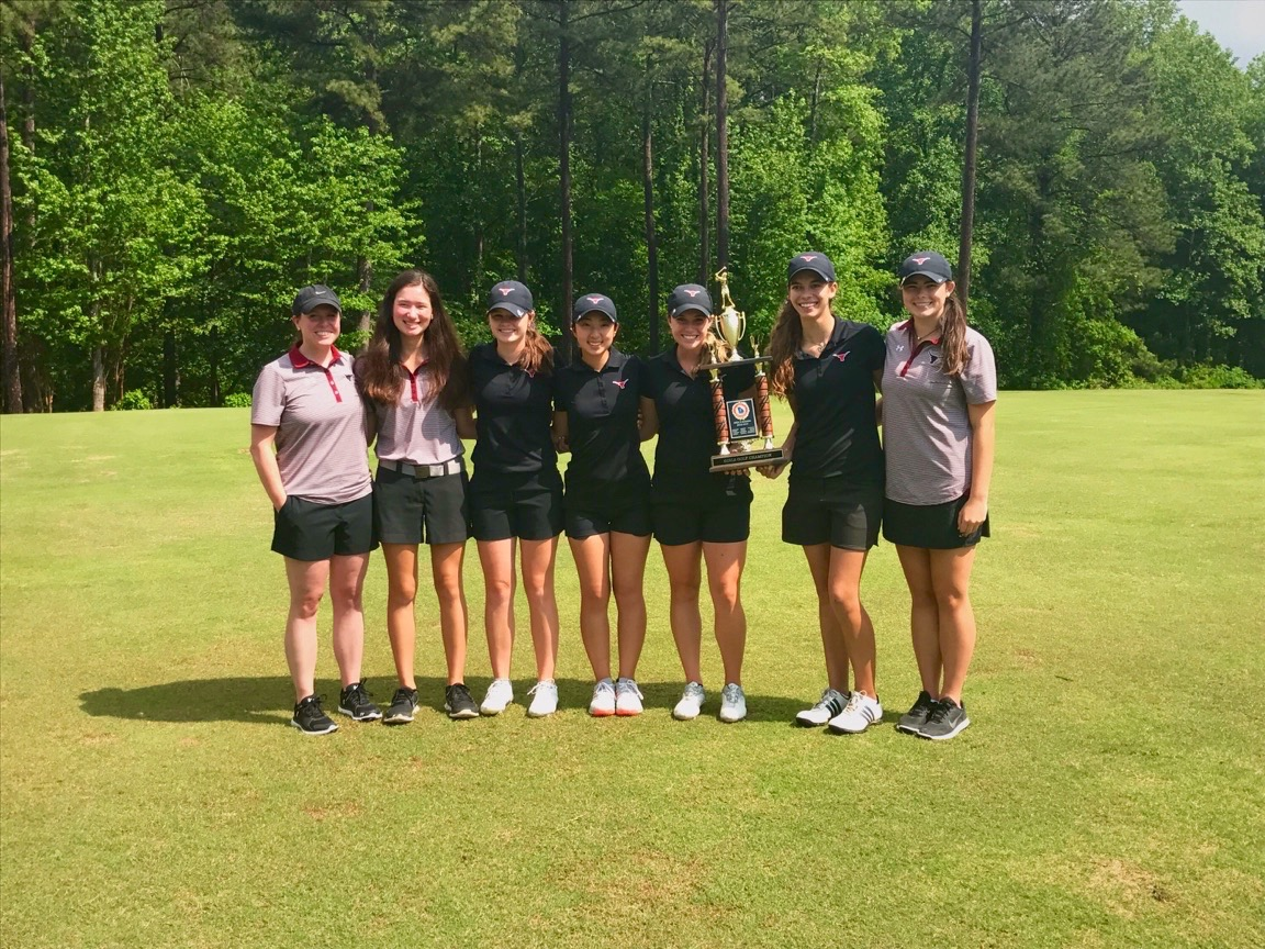 All smiles for the golf team with their eighth consecutive region championship.