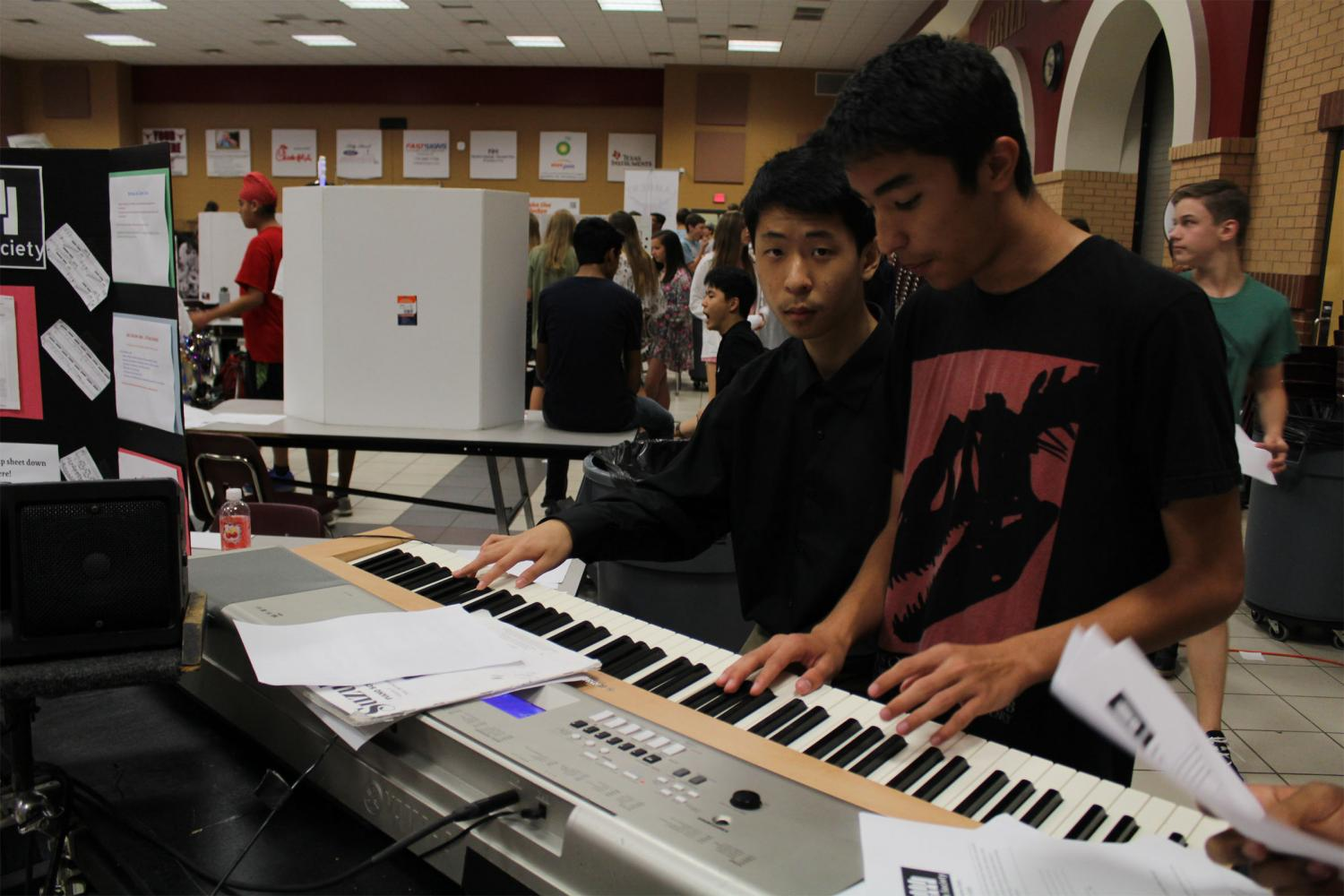 The Piano Club performs intricate pieces to attract new students.