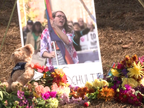 Flowers and stuffed animals can be seen placed around memorials for Schultz.