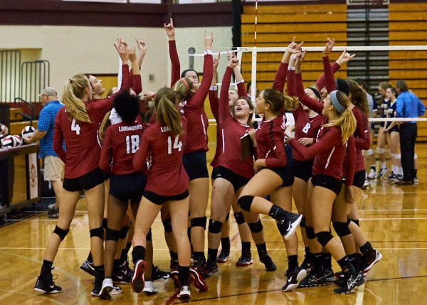 The volleyball team celebrates after a win that sends them into the elite eight round.