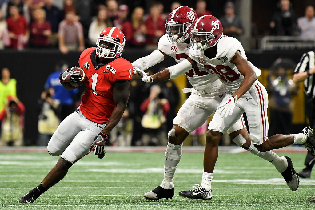 UGA senior RB Sony Michel tries to out run Bama defenders