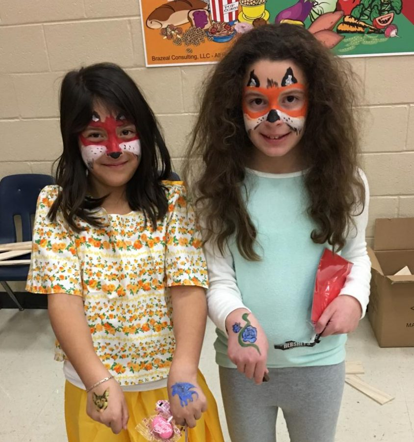 National Art Honors Society students happily volunteered to face paint at Sharon Elementary School's International Night.