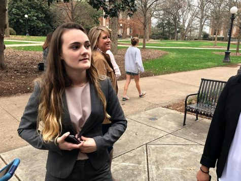 Senior, Diellza Koraqi, talks with her team mates outside the UGA law library after competing in the 2018 district mock trial competition.