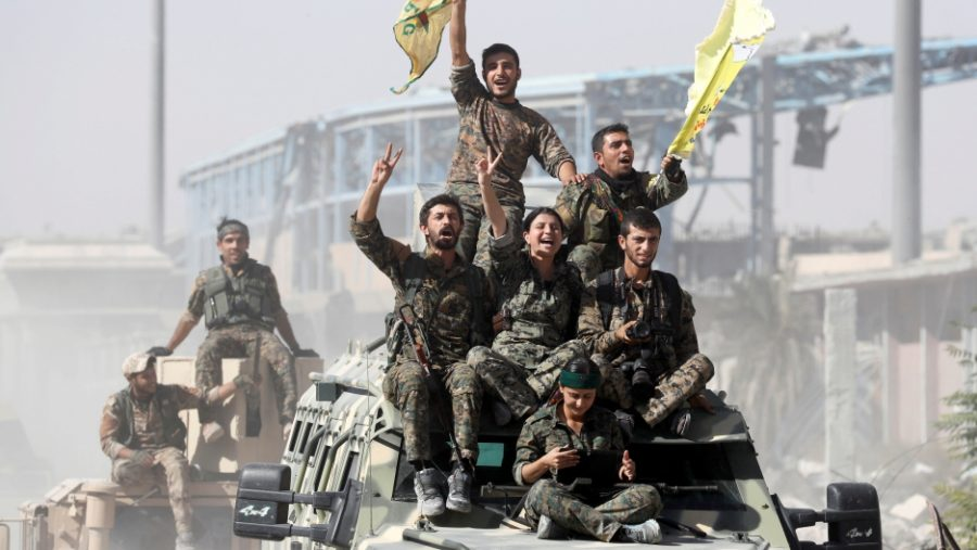 Syrian forces celebrate the liberation of Raqqa from ISIS control. Credit: Erik De Castro/Reuters, published on October 17, 2017, link to original https://media.pri.org/s3fs-public/styles/story_main/public/story/images/RTS1GUES.jpg?itok=w-7gAkg1