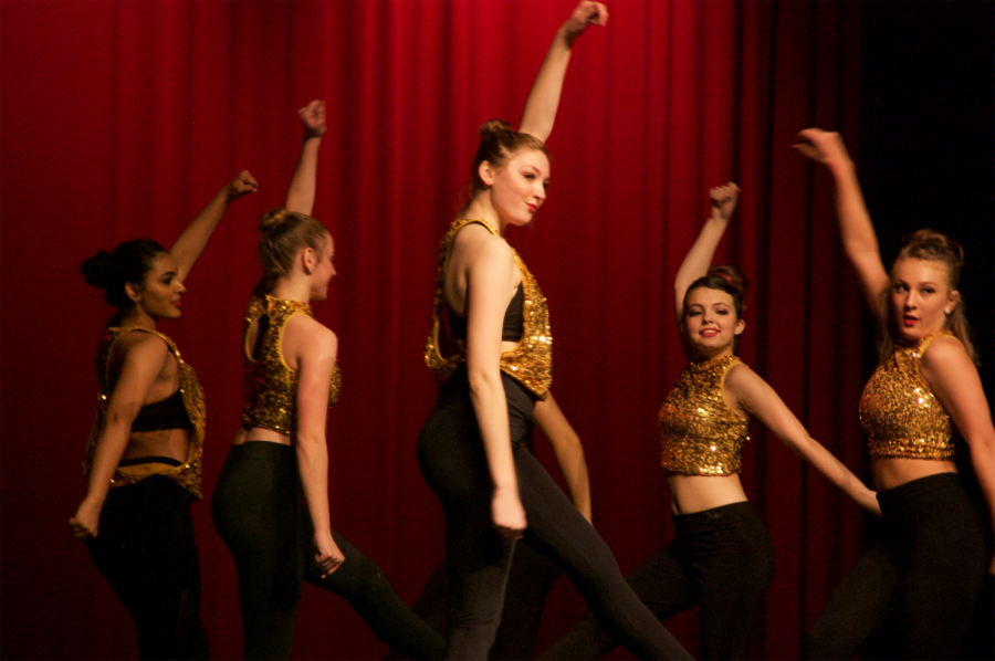 Rebel showcases the theme of the show - Captivate - with glittery costumes, a fun beat, and energetic movements.