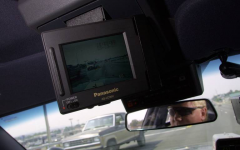 Outside Pierce County, public security departments have long been using dashboard cameras. Pasco police Officer Brad Gregory is cruising with a new video camera down Court Street to film the traffic in 2001. FILE HERALD FILE PHOTO EVAN PARKER, 2001.
