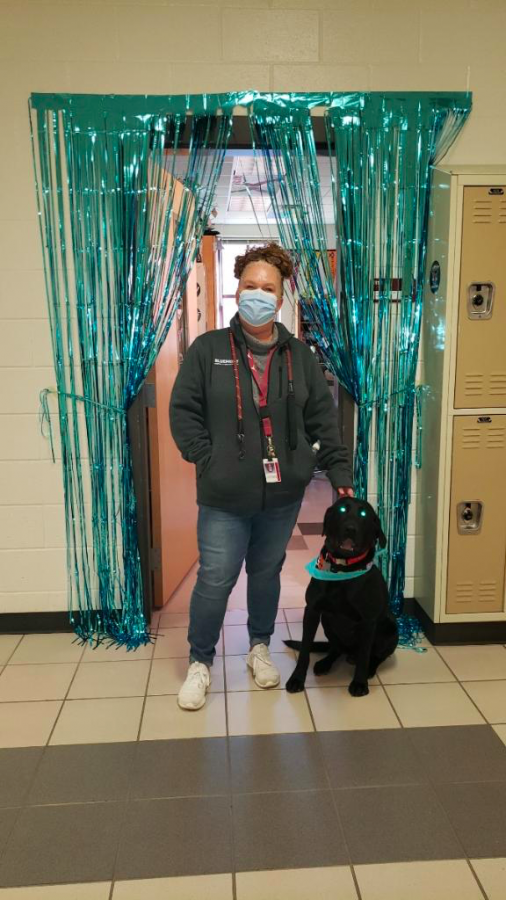 Mrs. Nicoletti and Duck posing in the 1800 hallway.